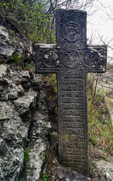 Stone cross on the hill opposite Bran Castle, Romania.