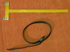 Checker und Spannriemen für das Bogenschießen