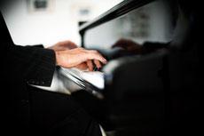 Am Klavier