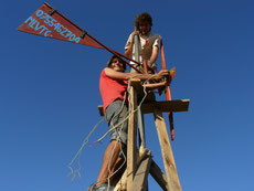 Oliver and Felix climb a selfmade windmill in Tanzania