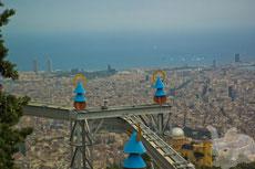 Американские горки Тибидабо на фоне умопомрачительной панорамы Барселоны