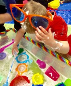 Child in messy play