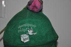 Ein verschwitztes Friedens-Cap mit Lotusblume