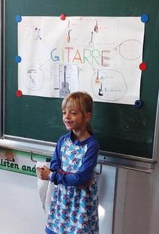 """Ich habe für mein Referat das Thema """"GITARRE"""" gewählt, weil ich seit diesem Jahr Gitarre spiele."""