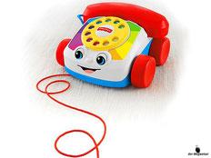 Im Paket Fisher-Price ist ein Plappertelefon mit Wählscheiben enthalten.
