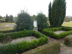 Grabanlage für sieben sowjetische Kriegsgefangene aus dem Stalag XB, verstorben im Arbeitskommando 7071 im Rüstjer Forst. Foto: M. Quelle