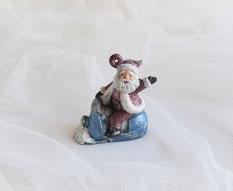 Nikolaus auf Schneemobil. Christbaumschmuck aus Keramik