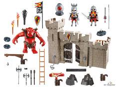 Im Paket Playmobil 5670 sind zwei Ritter ein Riesentroll  ein Burgtor ein Schwenkaufzug eine Leiter ein Torbalken ein Armbrustkanone zwei Geschosse zwei Felsen drei Steine eine Fahne und vielem Zubehör enthalten.