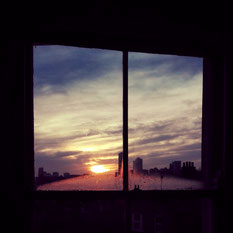 Sunrise in London from typical foggy window