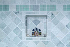 A tiled recessed shower shelf