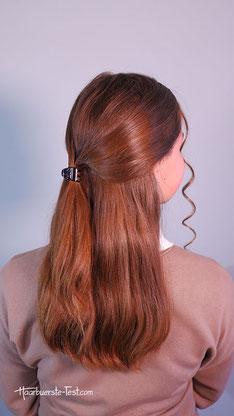 Dutt mit Haargummi