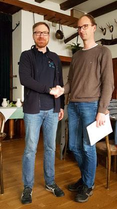 Christian Grau gratuliert Benjamin Deppe zum neuen Amt