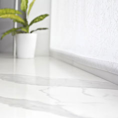 Natural and engineered stone windowsills can serve as extension to kitchen worktops