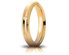 fede nuziale corona gialla con diamante