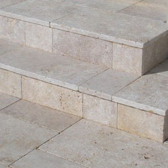 Who makes travertine stairs and facades in Lithuania