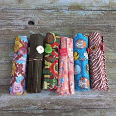 trousses roulees artisanales avec feutres ou crayons de couleur pour enfants ou grands