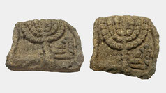 Ancient Judean carved limestone relief with menorah. seven-branched menorah