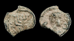 Ancient lead seal with menorah image