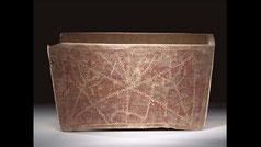 An ancient early Jewish limestone ossuary. Roman Period with menorahs