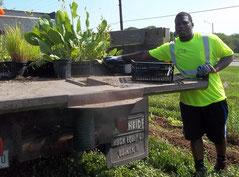 Demetrius Allen unloading some of the 450 plants.