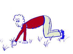 In der Wiese knieendes Männchen, das an Grasbüscheln zieht