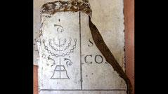 Menorah fragment Cathedral John Baptist Rome, Italy Basilica candelabrum stone