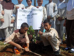 Jabal (left) taking the lead in planting trees