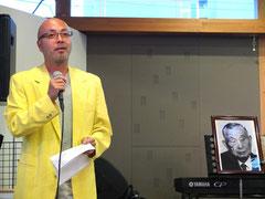 村山富市元首相のメッセージを代読する長澤理直事務局長
