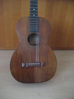 Oahu branded all koa Schmidt guitar with mahagoni neck and  ebony fretboard.