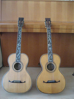 "Two high end Schmidt guitars. The ""Tree of life"" model was the top of the line guitar of Schmidt's production line. Selected spruce top, mahagoni back and sides, mahagoni neck, pearl inlaied fretboard, fancy purfling and full binding (body and neck)."