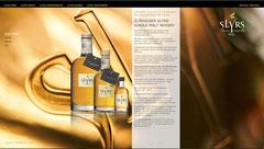 Das Bild zeigt eine Seite aus der Homepage der Fa. Slyrs mit drei Whisky-Flaschen