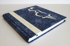 Geburtenbuch mit Storch