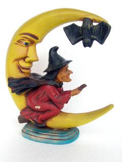figuras de brujas montadas en media Luna