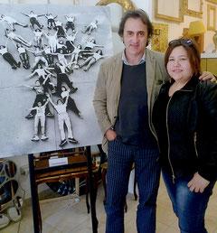 """Angelo Bonelli ed Elisa Martorana fotografati con l'opera """"L'Albero:quando la cronaca diventa arte"""""""