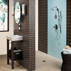 Brown and blue shower with beige floors.
