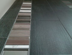 Grey, white, and metal mosaic set with black tiles.