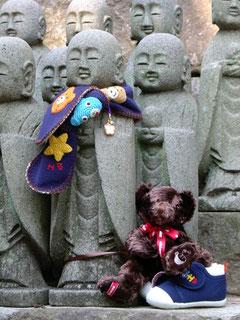 A clothed Jizo statue