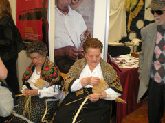 The Montappone ladies weaving at the Herbaria