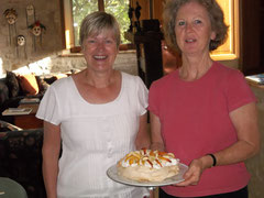 A lovely Mela Rosa guest with me holding the pavlova I had made to her recipe.