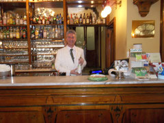 One of Caffè Meletti's waiters obligingly posed with a bottle of Anisetta