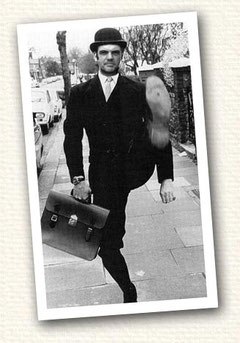 Steve Hartley as Minister of Silly Walks with briefcase and bowler.