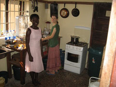 Hannah and her friend Joy, baking banana bread