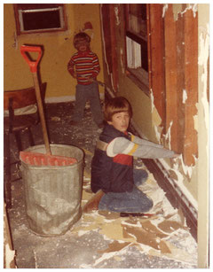 My brother and me (I'm the younger one) destroying some walls and breathing in some stuff we probably shouldn't have been breathing in.