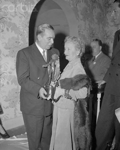 Mayor of NYC O'Dwyer as he presents the American Fashion Critics Award to Hattie Carnegie,1948