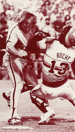 Pete Rose bowls over Astros catcher Bruce Bochy to score the go-ahead run in the 10th inning.