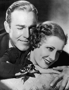 "Irene and Randy Scott, her leading man in ""Roberta"". Irene deftly handles her life so that a brilliant career and a happy marriage dovetail despite enforced separations during work"