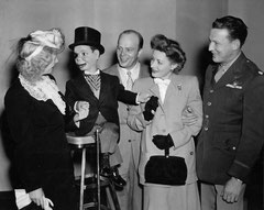"with ventroloquist Edgar Bergen, dummy ""Charlie McCarthy"" and unknown guests"