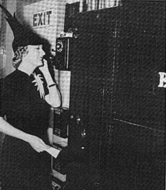 Managing her home from a soundstage, Irene Dunne talks on the phone during the filming of the 1937 Columbia feature, THE AWFUL TRUTH.