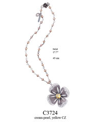 C3724: 150.00, OXI TWIST NECKLACE W/ CREAM PEARLS, FILIGREE FLOWER W/ A YELLOW CZ IN THE CENTER.