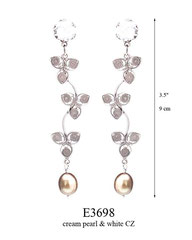 E3698: 85.00, OXI POST EARRING, WHITE CZ IN CUP,  3 FILIGREE FLOWERS ON A CURVED STICK.